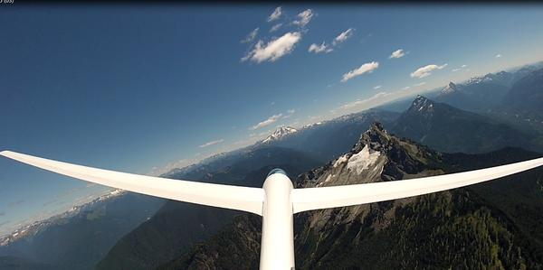 LS3 sailplane homing in on the clouds. Surprisingly, the thermals that produced those clouds provided good climbs. Peaks from L to R: Glacier Peak, White Chuck Mountain, Mt. Pugh, and Sloan Peak